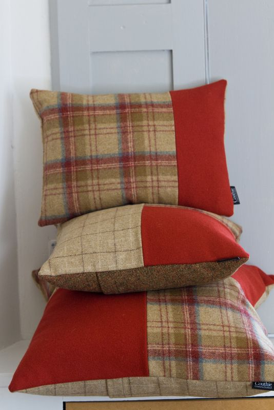 Couthie handmade tweed cushions in victory red and sandy beige.