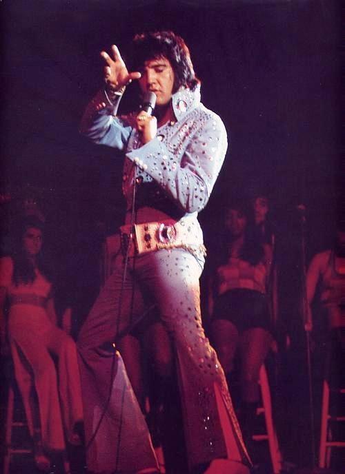 Elvis karate moves on stage