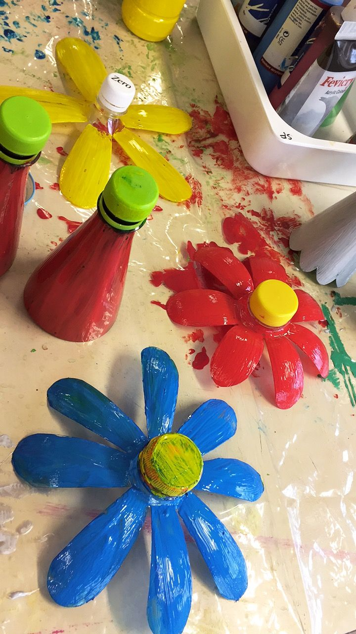 Plus de 25 id es uniques dans la cat gorie fleurs avec bouteilles plastique sur pinterest id e - Fleur bouteille plastique ...