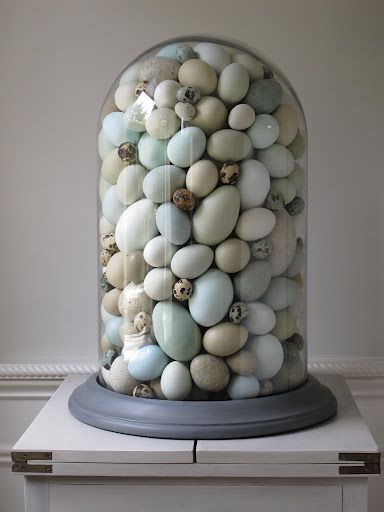Eric used all blown out eggs in his display, he covered the holes with a tiny piece of paper that was colored to match the egg.
