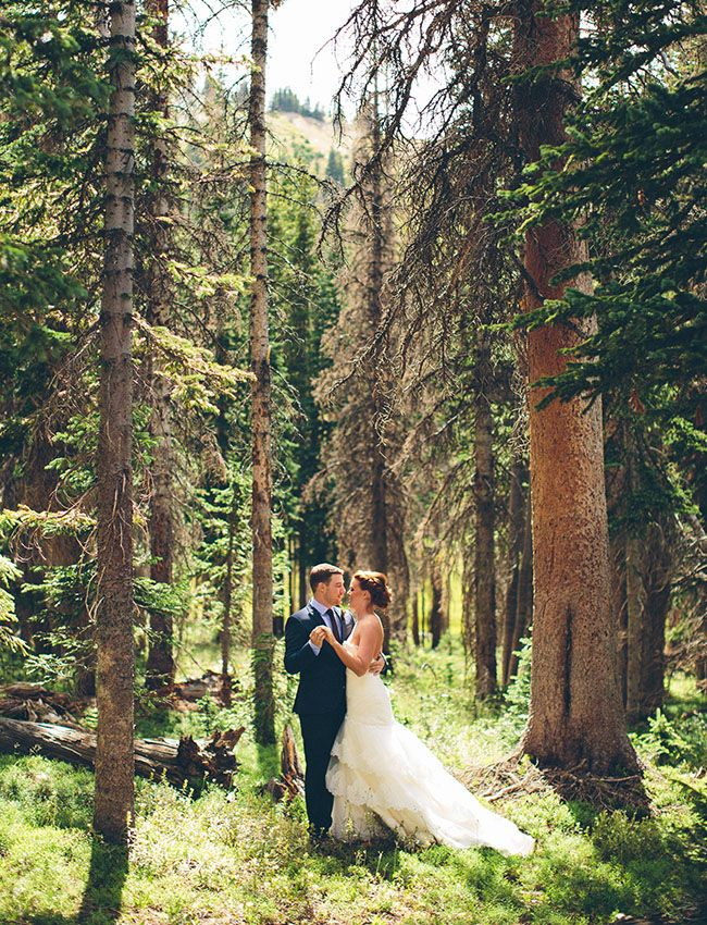 Faith + Kevin knew when they started planning their wedding was that they had to exchange their vows amidst the epic scenery of Wyoming's Snowy Mountain Range.