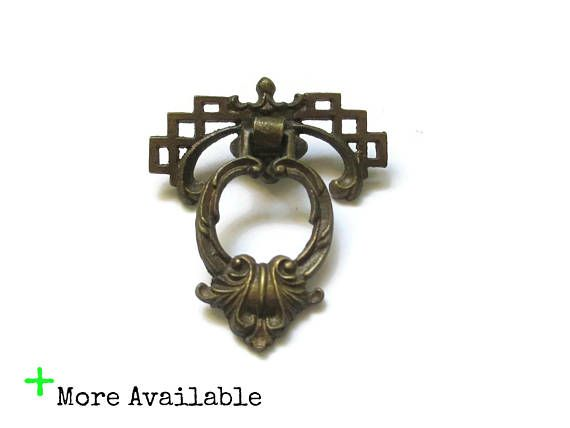 This listing is for 1 vintage drawer pull and the single screw and tiny nail for installation -Great worn brass patina. These are nice, substantial old pulls. The backplates are attached, but the drop pull part swings freely. -Measurements: 2 1/8 wide, 2 3/8 tall   International shipping is available for almost every item in my shop, send me a message if your country isnt listed or for the best rates on combined shipping.  Send me a message with any questions.  Location: X18