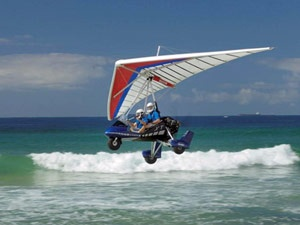 Microlight flying over surf near Newcastle, NSW Via: http://www.airborneupperhunter.com.au/