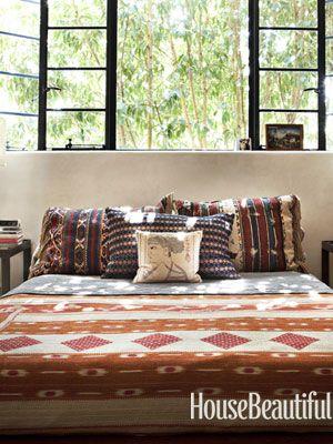 Vintage textiles. Design: Commune Design. Photo: Amy Neunsinger. housebeautiful.com. #bedroom #vintage #textiles #vintagefabric