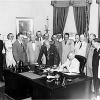 President Harry S. Truman Signing National Security Act Amendment of 1949