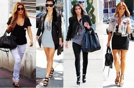 Kim Kardashian (: she is such a big fashion icon to me she always has different kinds of clothes all different kinds of stlye shes always mixing her look up thats what i like about her & she always look absolutely beauts i would love to dress like her in everyway (: & my definition of fashion is like the way you do your hair, the different kinds of ways you do your make up, the fashion trends that you wear , heels & pretty shoes thats kind of my definition,