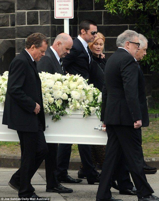 Comfort: Australian actor Hugh Jackman comforted his bereaved wife Deborra-Lee Furness as ...