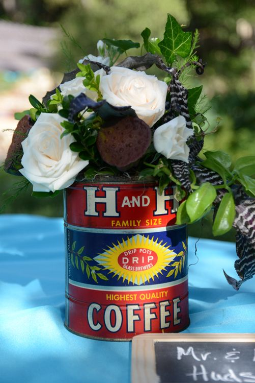 Coffee themed wedding. Using a vintage coffee can with succulents and floral accents.