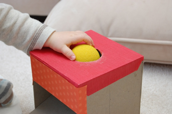 do it yourself montessori box and ball for developing object permanence starting around 8 months