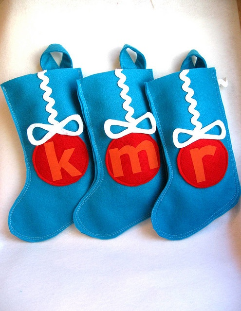Cute felt stockings...love the idea of just the monogram. Could use any shape....maybe a flower for each girls name.
