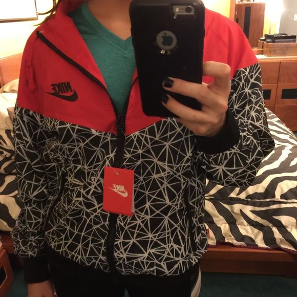 Nike windbreaker Super cute never worn besides for modeling purposes. small available. Fits about a half a size to a size smaller. Nike Jackets & Coats