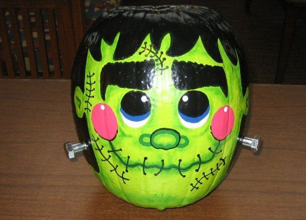 Jennifer P. of Toivola, MI created this colorful Frankenstein for our 2013 Pumpkin Carving Contest | thisoldhouse.com
