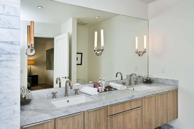 Dual vanities and marble countertops decorate the master bathroom.