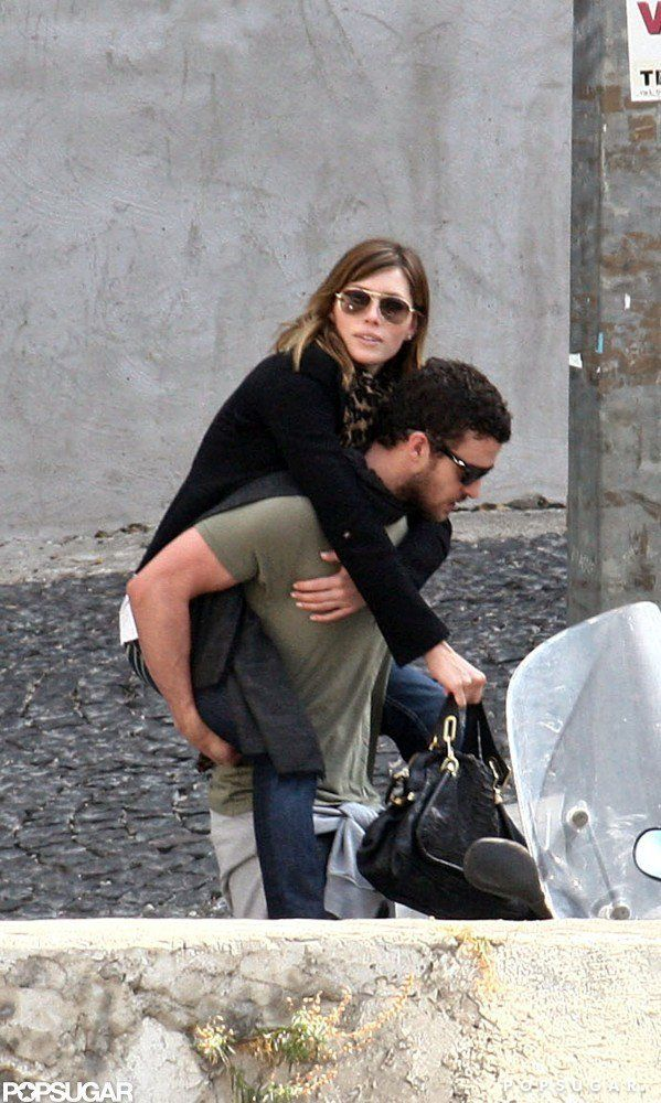 Pin for Later: 46 Photos of Justin Timberlake and Jessica Biel's Love Through the Years  In September 2008, Jessica hopped on Justin's back while they toured Rome.