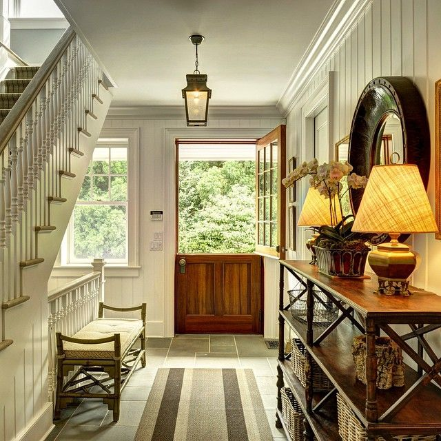 Relaxed entryway with Dutch door, lantern, painted paneling - Tom Samet