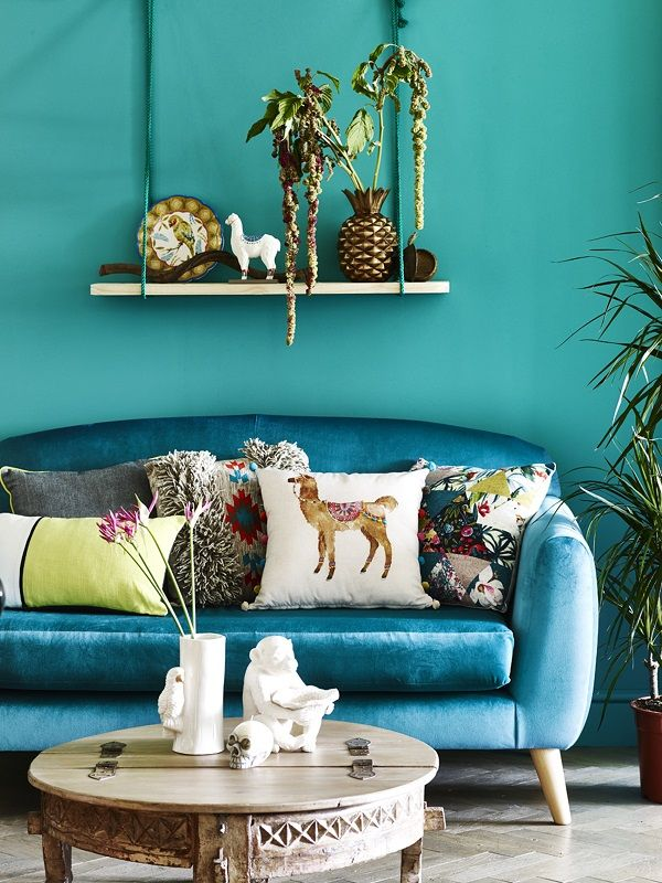 teal walls and bright colours living room hanging shelf with plants eclectic boho
