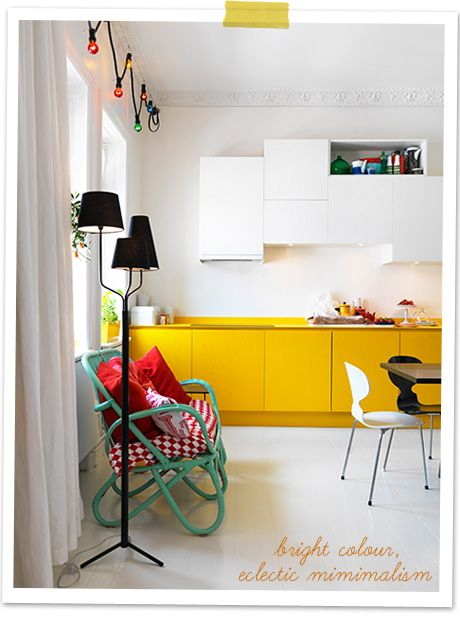 Your home needs to be fun and cozy... The yellow cupboards look fun and the cane love seat looks so cozy!!!