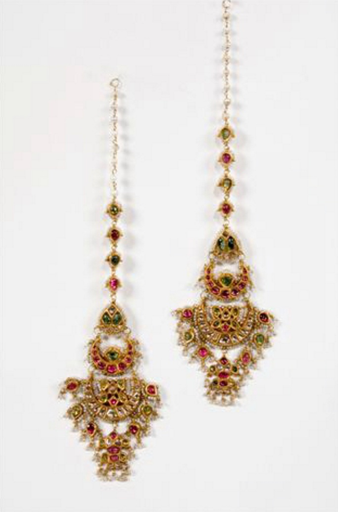 A pair of traditional earpendants A pair of gold traditional ear pendants consisting of a double crescent moon and a fish, set with rubies, emeralds, diamonds and suspended pearls India, Rajasthan early 19th century