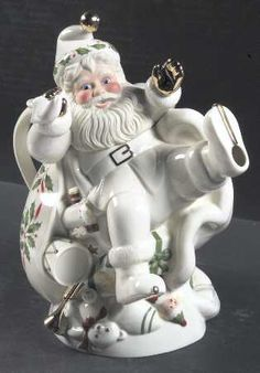 Lenox Santa Holiday Teapot ... in shape of Santa Claus dressed in white kicking up feet in chair decorated w/ Chrismas holly, bone china, USA
