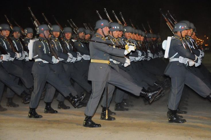Officers and cadets of the Sgt. Daniel Rebolledo Sepulveda NCO School marching past the Votive Temple of Maipú at the school's award ceremony on Chilean Army Day, 2015.
