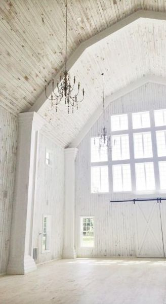clean white barn space for a wedding reception