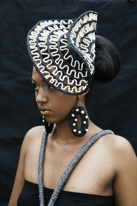 Black and white headpiece and earrings made from handwoven lutindzi grass and tree beans by Gone Rural. #ruraltoramp