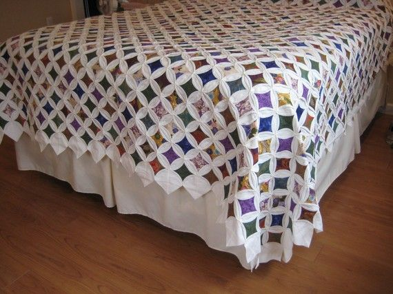 Unique Cathedral Window design 95 x 105 Quilt  This quilt is from a traditional American Amish Community in Pennsylvania    Vibrant colors backed in beige fabric Quilt edges are the same all around, no batting    Quilt is shown draped over queen size bed. It would also make a nice coverlet for a king size bed. (Dust Ruffle shown in photos is not included) Shipping cost is approximate. Actual cost will be calculated at sale  depending upon shipping location.