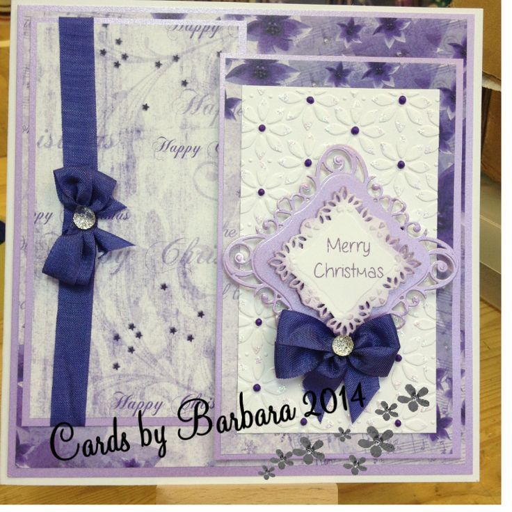 made in lilac & white using Christmas background papers, Christmas sentiment, Sue Wilson embossing folder and finished with bows made with seam binding topped  with dazzlers