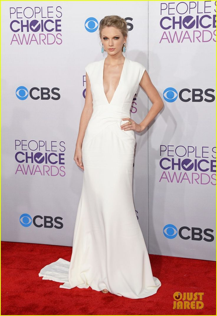 Taylor Swift - People's Choice Awards 2013 Red Carpet. She is wearing a Ralph Lauren Collection dress, Christian Louboutin shoes, Sutra earrings, and a Le Vian ring.
