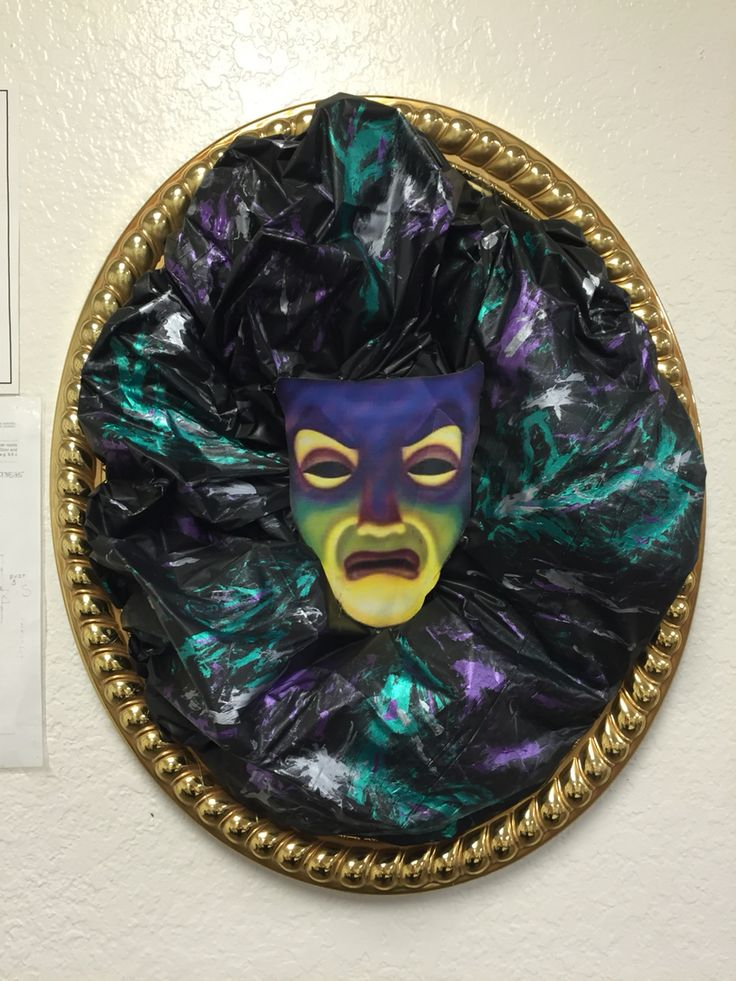 Made this for Disney villains party at work. Frame, black table cloth, paint and a print out of his face! Super easy!
