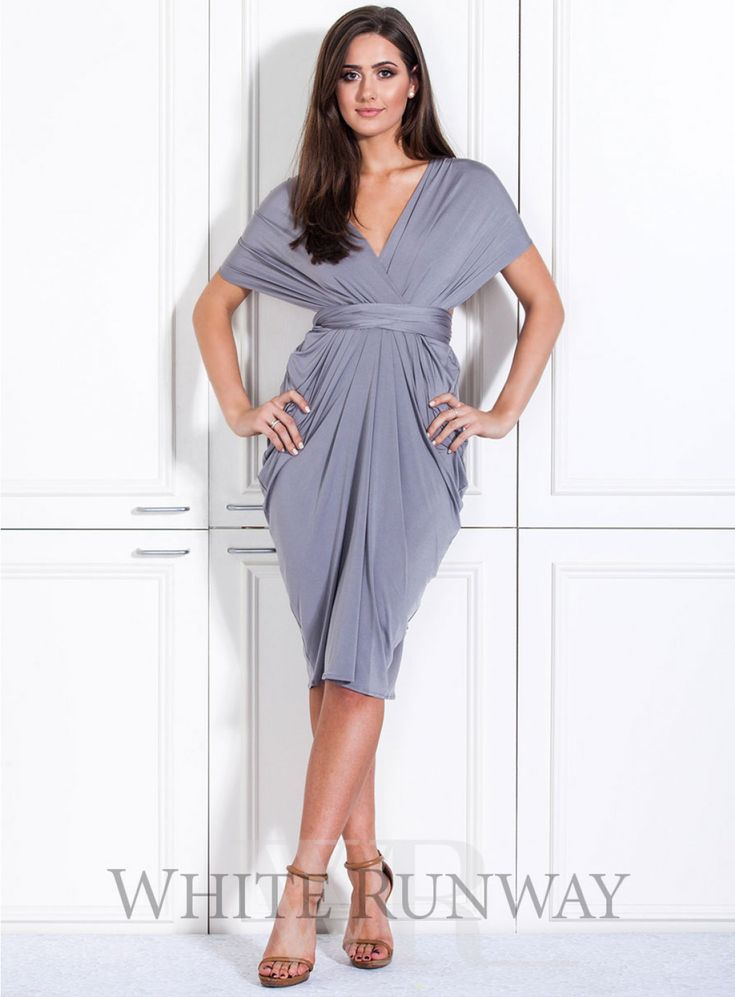 Goddess Cocktail Dress. **Dresses are custom made to order so no returns are accepted on this style. Please contact us if you would like to arrange a sample order.** A beautifully draped multi-way dress by Nicolangela. Made of a beautiful poly, spandex blend knit that can be styled over 8 different ways.