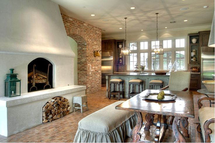 French-Inspired Kitchens with a fireplace in the kitchen. Wish I had a fireplace that could double as a wood oven.  #cultivateit