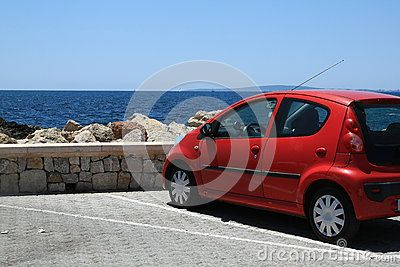 Parked car on the waterfront. Carrer Pagell, Playa de Palma. Mallorca, Spain
