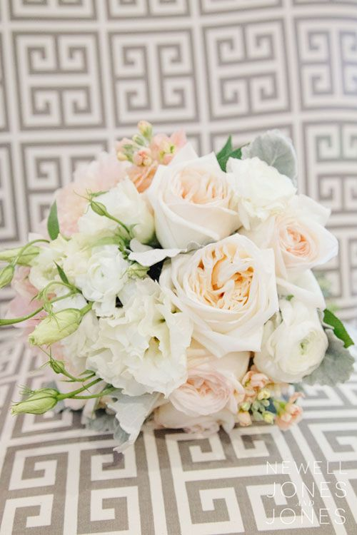 Wedding Bouquet - This dreamy bridal bouquet is composed of blush O'Hara garden roses, white ranunculus, white lisianthus, peach stock, and dusty miller. (Submitted by Painted Primrose Florist; Photo by Newell Jones & Jones Photography)