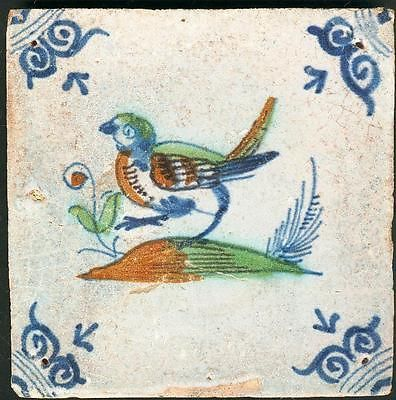 Antique Delft tile with bird, 17th century.