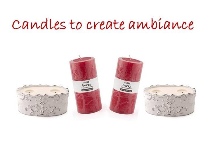 Candles to creat ambiance. Items include: Waxfill Scroll-Pot White, Pillar 3X6 Strawberry