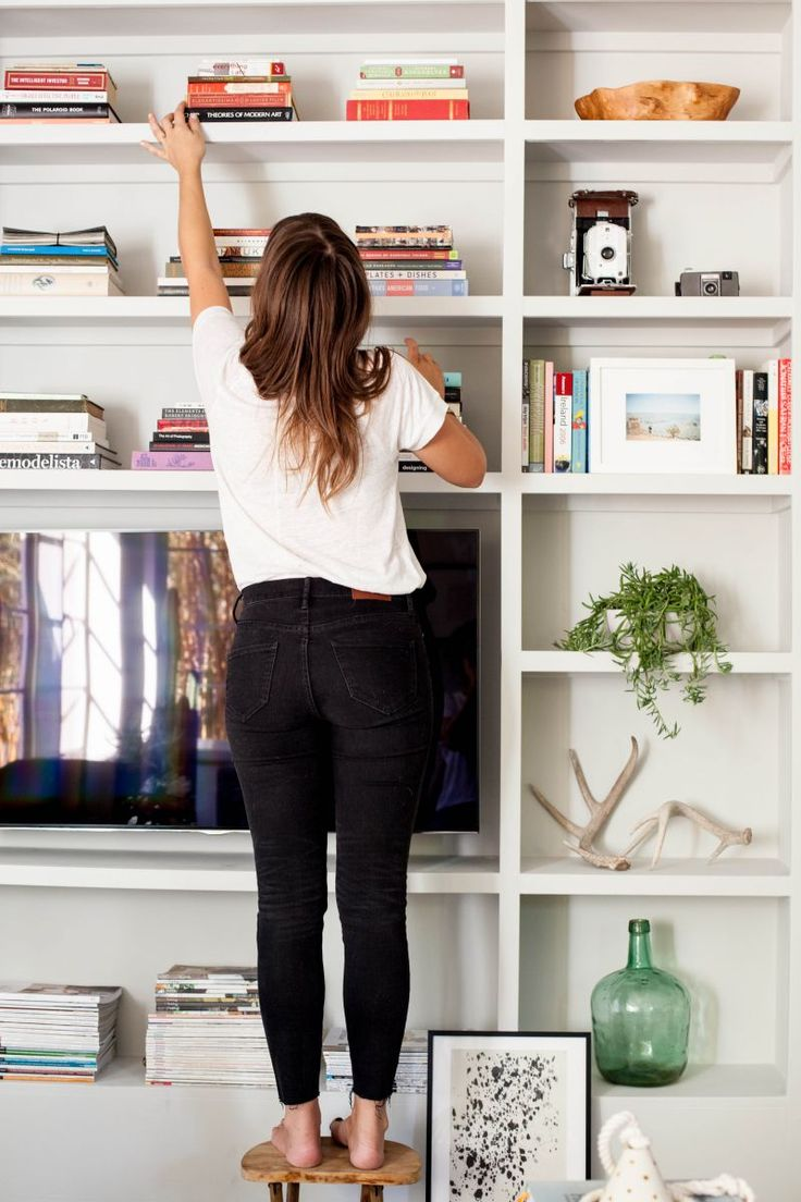 Loving the bookcase-TV set up - Chelsea Fullerton's Austin, Texas Home Tour #theeverygirl