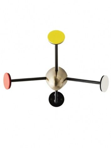 The multicoloured Coatrack with its black lacquer finish and striking brass centerpiece as Matégot's unique, functional