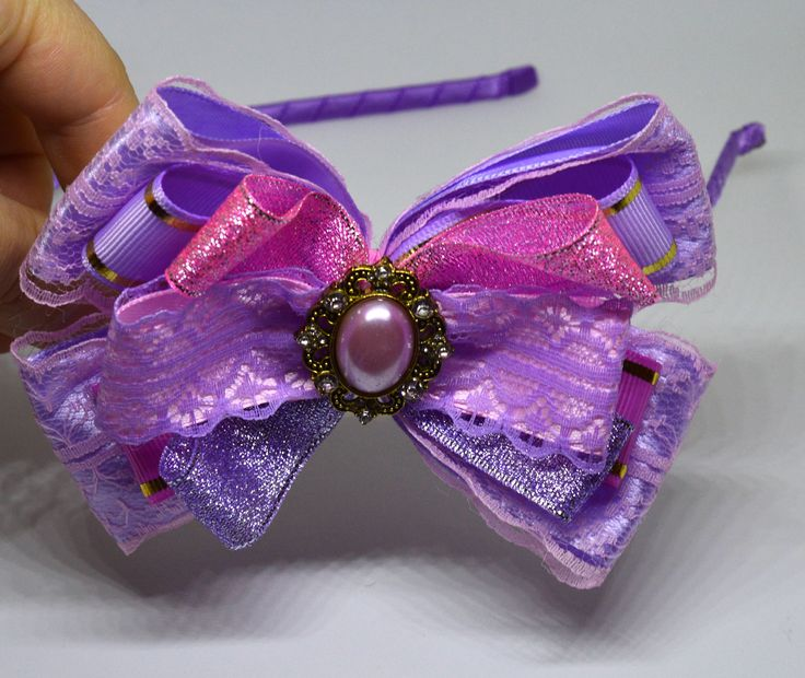 A personal favorite from my Etsy shop https://www.etsy.com/listing/576046433/handmade-headband-purple-and-pink