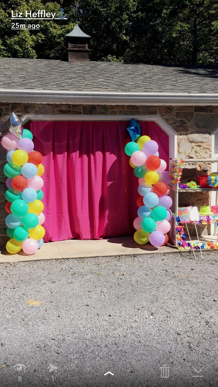 Homemade Photo Booth  Oversized table cloth in front of garage with handmade balloon towers!