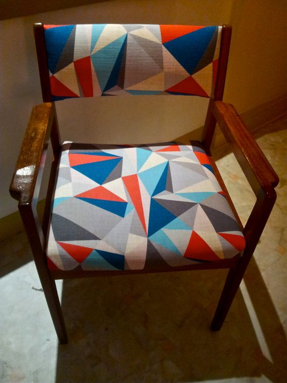 Beautiful wooden chairs, refitted in funky geometric fabric