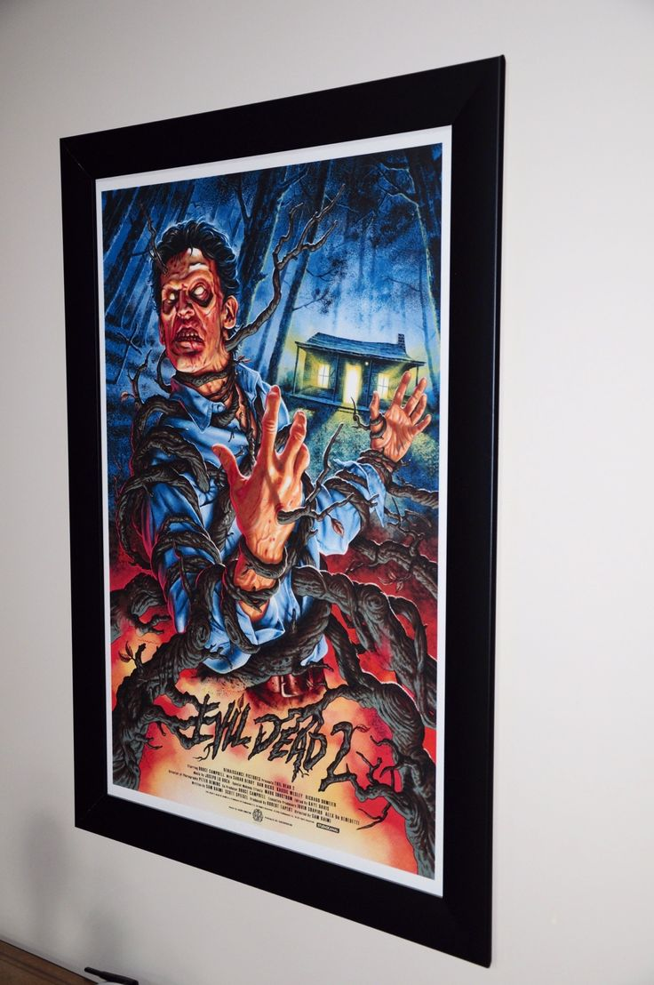Evil Dead 2 by @JasonEdmiston purchased from @Mondo News just Awesome Colors and Artwork!!! And I have to say it looks great in our frame!