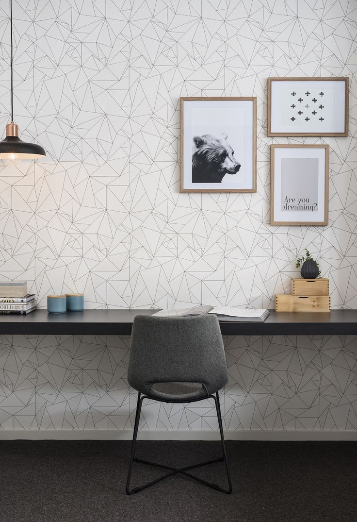 Create a unique study space by adding geometric patterned wall paper and metallic pendant light.