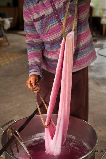 Woman dyeing silk at Soieries du Mekong silk mill near Sisophon.
