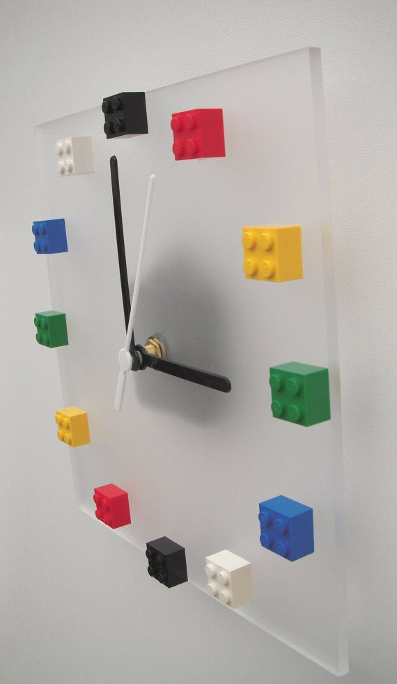 These clocks are made with recycled Lego bricks on a clear frosted acrylic clock face. · 20cm square, 5mm thick, clear frost acrylic clock face ·
