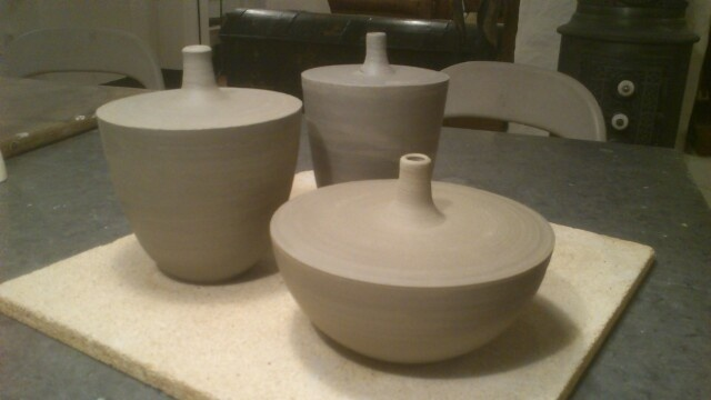 Newly wheel-thrown bowl vases.