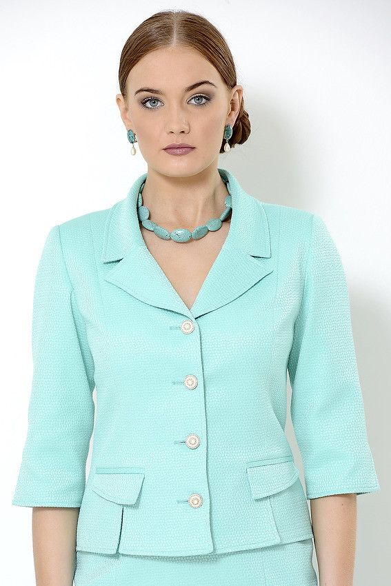 Greer Jacket Fully lined turquoise jacket with 3/4 sleeves, false pockets and slits at eh hem. Cotton-polyester blend.