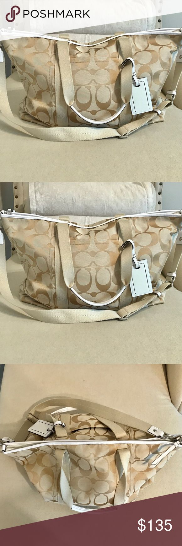 Coach Travel Bag Perfect condition Coach travel bag. Gold and cream signature. One pouch outside and 3 pouches plus zipper pouch inside. Removable shoulder strap. Lots of room. Coach Bags Travel Bags