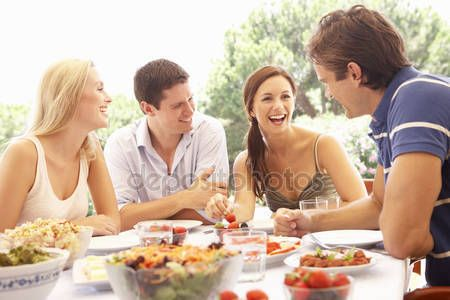 People Stock Images , People Pictures , person photo , - Two young couples eating outdoors
