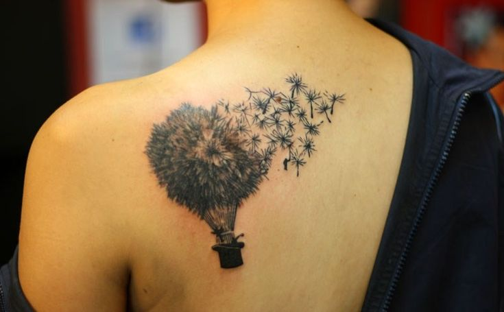 A dandelion tattoo design is simple, but can express many different emotions, like joy for life, one's belief that dreams come true.